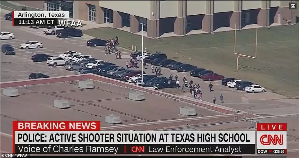Students are seen above leaving the school on Wednesday after the 'all clear' was given