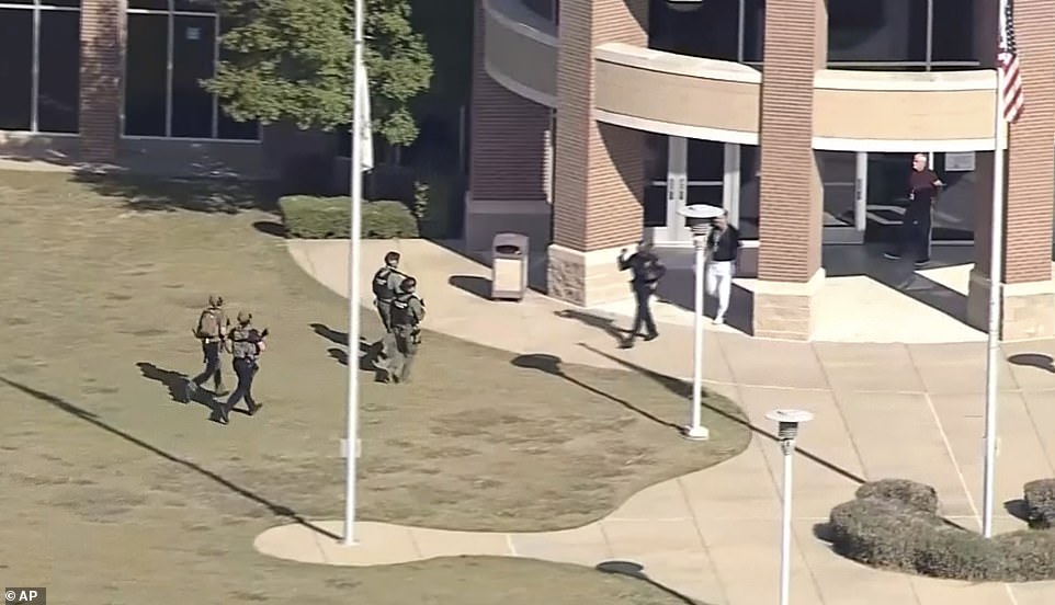 In this image from WFAA-TV video, law enforcement arrives at Timberview High School on Wednesday